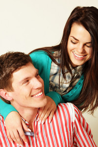 Smiling young couple isolated