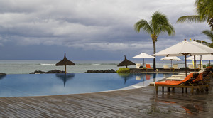 Smooth swimming pool on a stormy day at a tropical resort