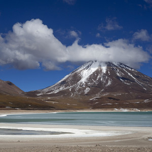 Snow-capped mountain and a smooth beach