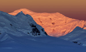Snowy peaks illuminated at sunset