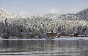 Snowy village on the edge of a lake