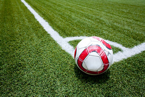 Soccer ball on the field corner