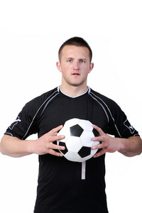 Soccer player holding a football isolated on white background