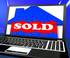 Sold On House On Laptop Shows Sold Property