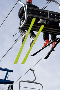 Some people ride the chair lift to the top of the mountain so they can ski back down.
