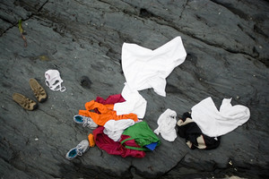 Some swimmers went skinny dipping in the ocean and left their clothes behind on the rocks ashore.