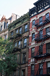 Some vintage tenement buildings with iron fire escapes.