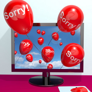 Sorry Balloons From Computer Showing Online Apology Regret Or Remorse
