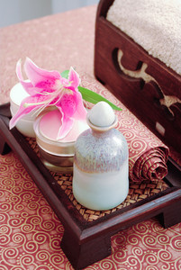Spa products of Thailand set on spa bed