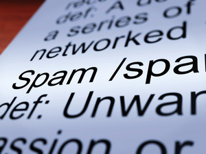 Spam Definition Closeup Showing Unwanted Email