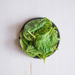 Spinach On Wooden Background