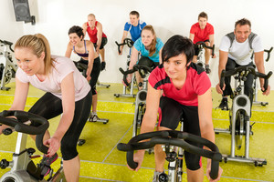 Spinning class people at the gym enjoy physical workout
