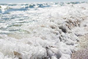 Splashing waves on sea shore. Photo of sea photographed on shallow depth of field