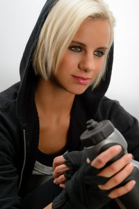 Sport blond woman wear black hoodie fitness outfit kick-boxer