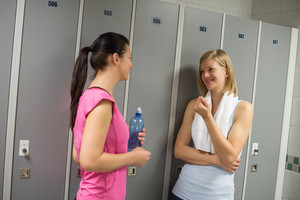Sport women talking in locker room at healthclub