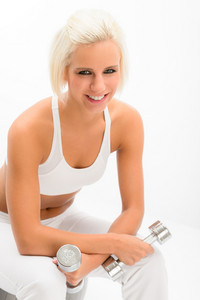 Sportive blond woman holding weights portrait isolated on white