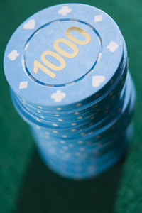 Stack of betting chips on green baize