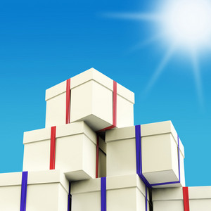 Stack Of Giftboxes With Sun And Sky Background As Presents For The Family
