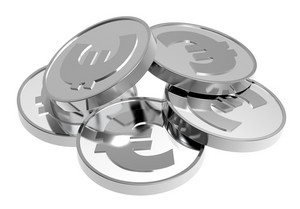 Stacks Of Silver Coins Isolated On A White Background.