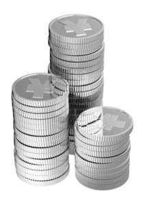 Stacks Of Silver Yen Coins Isolated On A White Background.