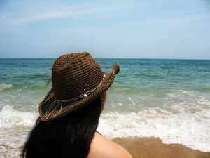 Staring out into the horizon on a bright day at the beach - Assateague Island, located near Ocean City, Maryland.  This is the island where wild horses are native and roam free.