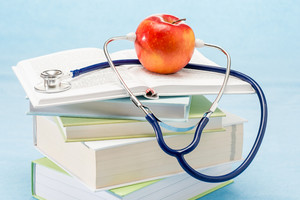 Stethoscope and apple medical healthcare healthy lifestyle doctor book