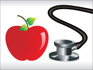 Stethoscope And Red Apple