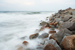 Stone breakwater photographed on long exposure