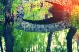 Stone bridge reflection in a lake