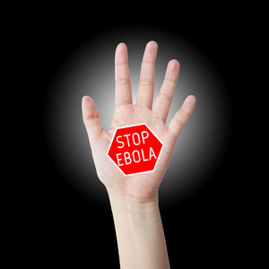 Stop ebola hand leader in black background