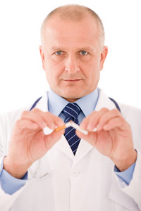 Stop smoking mature doctor male breaks cigarette focus on hand