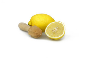 Lemon With Wooden Reamer On White Background