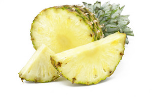 Half Cut Pineapple With Slices On White Background