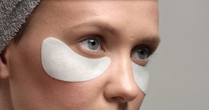 30's woman with an eye patches on closeup