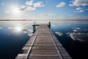 A jetty on a beautiful still lake