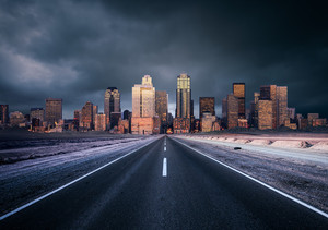 A road heading into a moody city