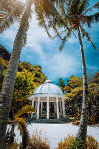 Abandoned Matinloc Shrine between two palm trees at the western coast of Matinloc Island at Palawan, Philippines