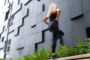 Active Woman Performing Step Workout Outdoor in the City