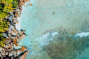 Aerial drone bird eye shot of beautiful paradise like tropical beach at Seychelles