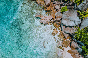 Aerial drone landscape of seychelles tropical paradise anse cocos beach with pure crystal clear turquoise water and bizarre granite rocks. La Digue Island