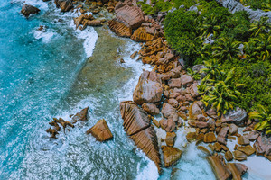 Aerial drone photo of stony part of beautiful anse cocos beach at La Digue, Seychelles