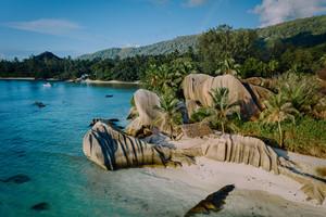 Aerial drone view of unique Anse Source D'Argent tropical beach, La Digue Seychelles. Luxury exotic romantic travel honeymoon concept
