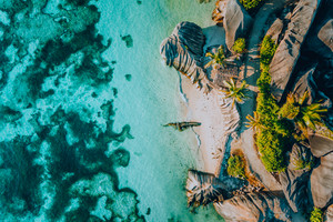 Aerial photo of famous paradiselike tropical beach Anse Source D Argent at La Digue island, Seychelles. Summer vacation, travel and lifestyle concept