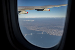 aerial view from plane window over Akashi-Kaikyo Bridge crossing osaka bay japan