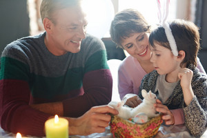 Affectionate family having talk on Easter day