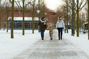 Affectionate family taking walk in park on wintery day