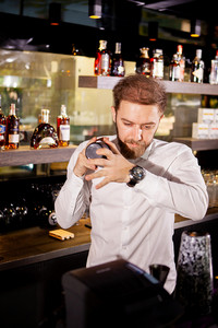Alcohol cocktail on the bar. Bartender prepares an alcoholic cocktail . Delicious drink