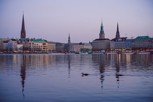 Alster river and Hamburg town hall - Rathaus at spring in evening twilight