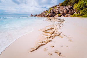 Amazing Granite rocks, white sand and blue clear ocean at Grand Anse, La Digue island, Seychelles. Nature background