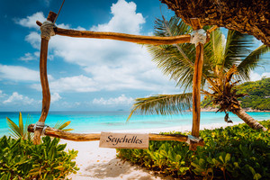 Amazing tropical scene with bamboo frame on the white sand beach against turquoise sea. Vacation in paradise. mahe Island, Seychelles